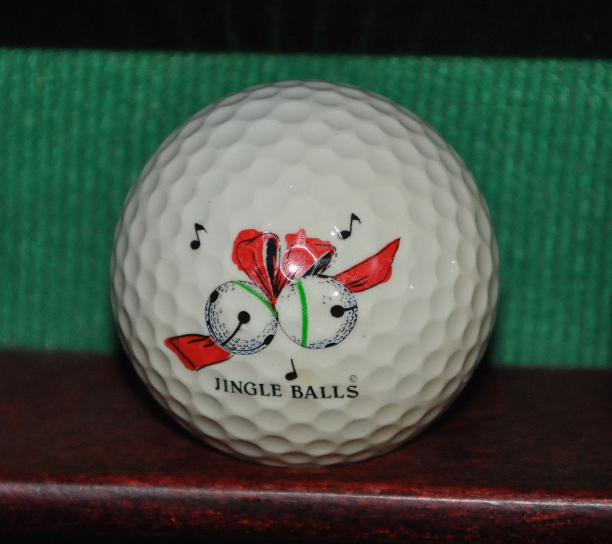 Jingle Balls Festive Christmas Logo Golf Ball Ball is in very good condition with light evidence of play (pictured). The ball pictured is the ball for sale.