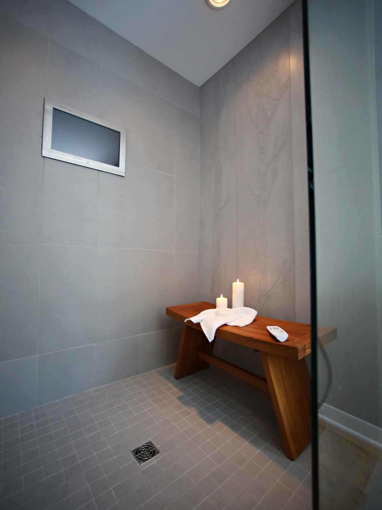 A candlelit shower with a handcrafted cedar bench completed with a ...