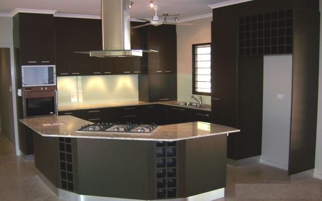 Modern look kitchen with bar and dark cabinets