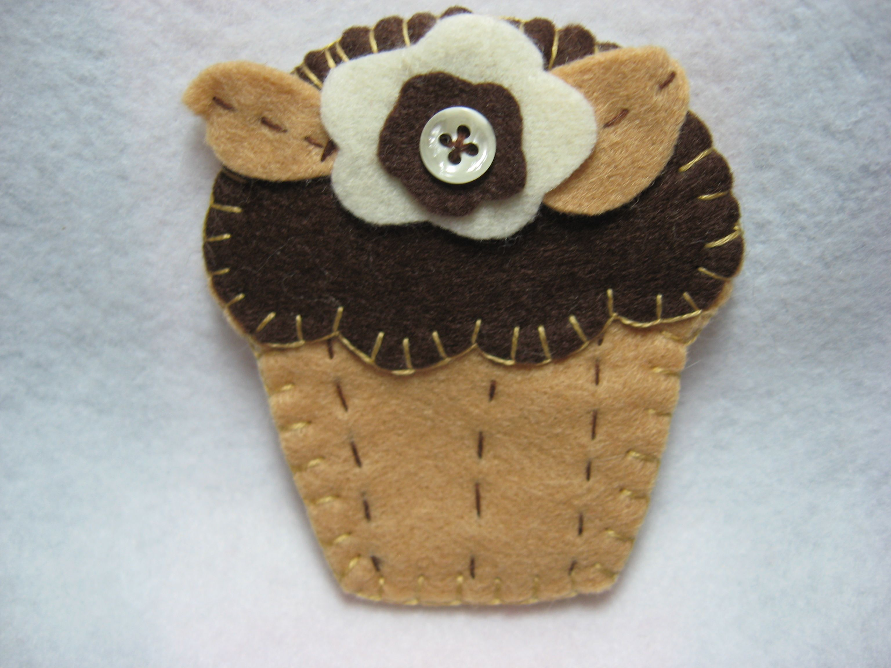 Needle Case / Book made of wool felt. Made to look like spice cake with chocolate frosting