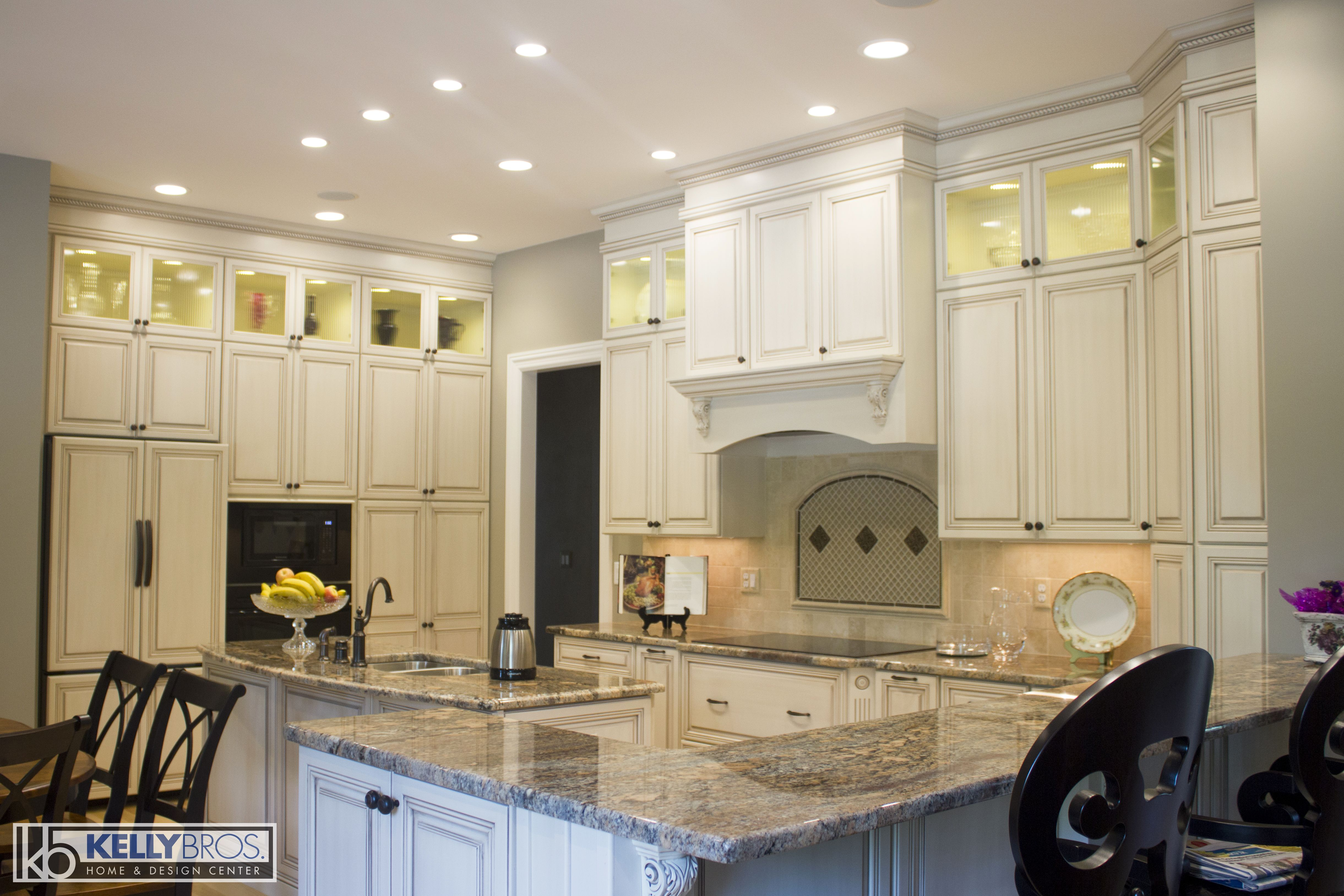 Designed By Troy Russell Dynasty Omega Cabinetry Destin In Oyster Cognac W A Brushed Glaze Granite From O Cool Kitchens Omega Cabinetry Modern Kitchen Design
