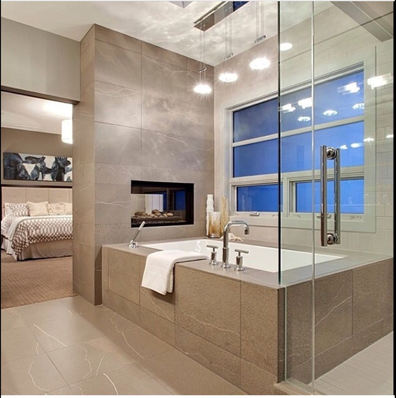 two-way fireplace separates bedroom and bath | Cozy ...