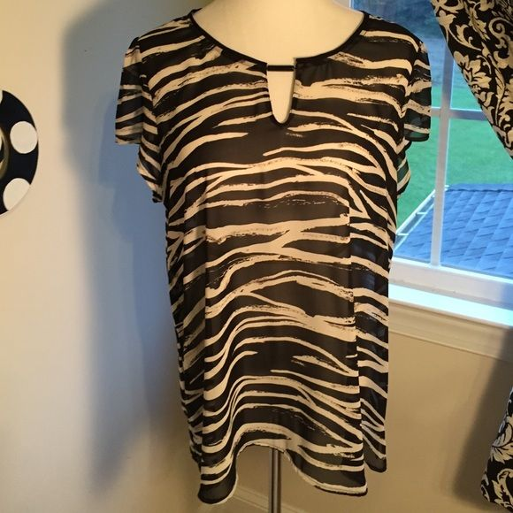 Like new Madison zebra print top! XL This Madison top is gorgeous and oh so comfortable! Sheet fabric...perfect with cami underneath!! Must have for your wardrobe!! It does not fit me :( Barely worn, so no imperfections! Great detail at neck... Madison Tops Blouses