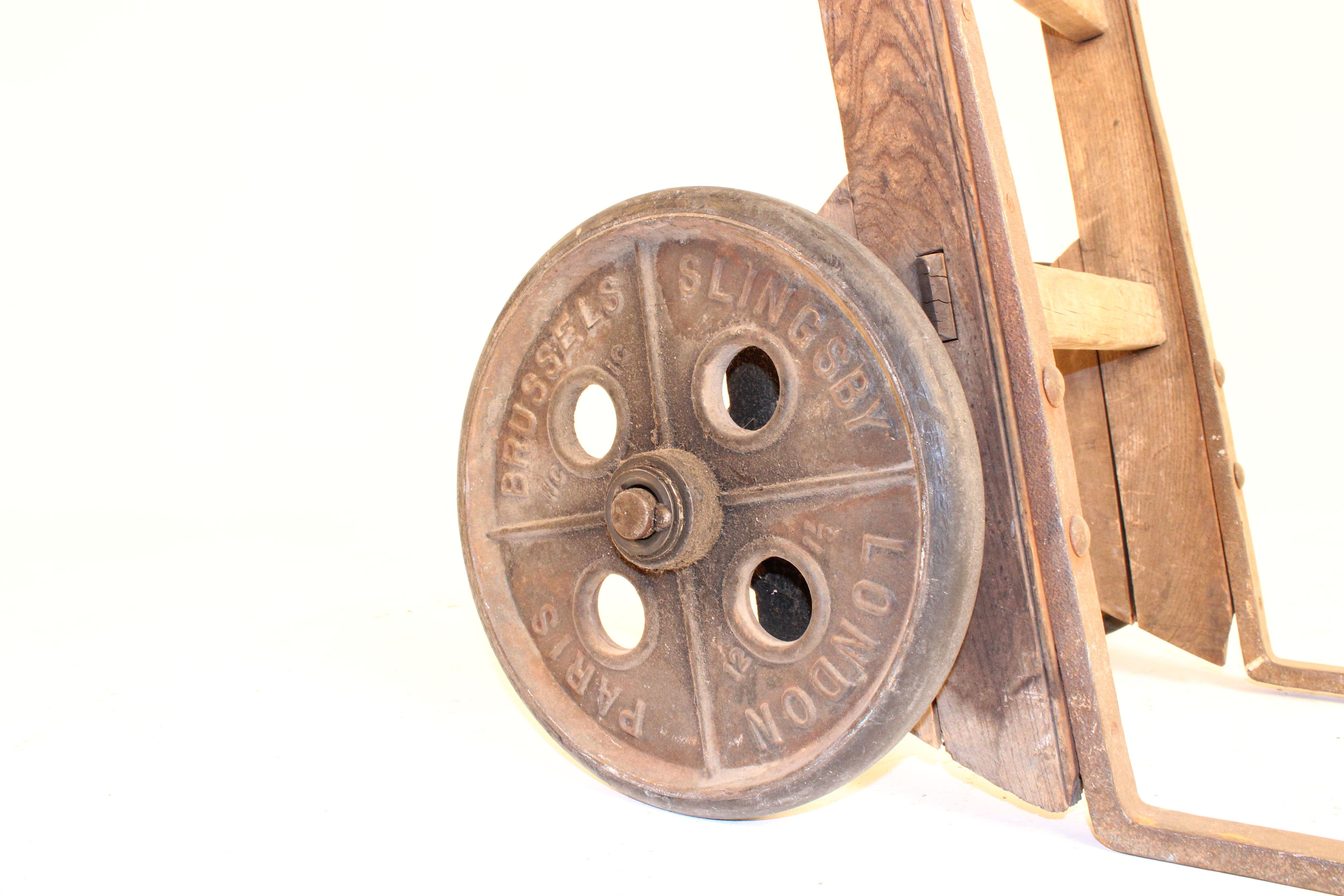 Slingsby cast iron wheel on wooden handtruck. Quality that lasts a lifetime