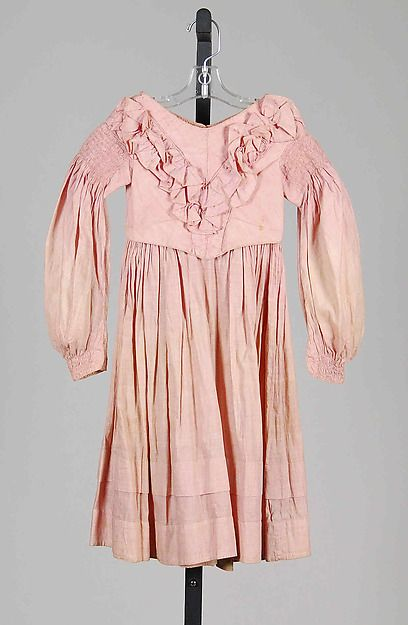 Pink Cotton Girl's Dress, circa 1837-39 | From the very first years of Victoria's reign, this 1830s dress has banded-down gigot sleeves and a slight dip at the front of waist. #Early #Victorian #1830s