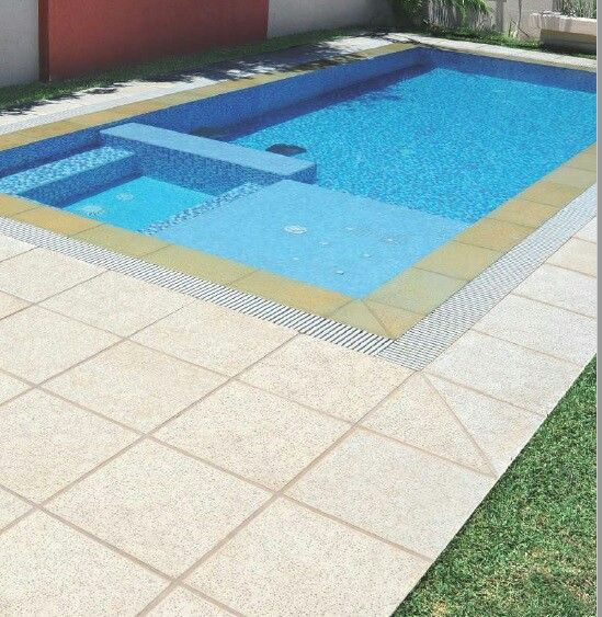 Rectangular Swimming Pool With Patio By Culzoni Decking And Coping