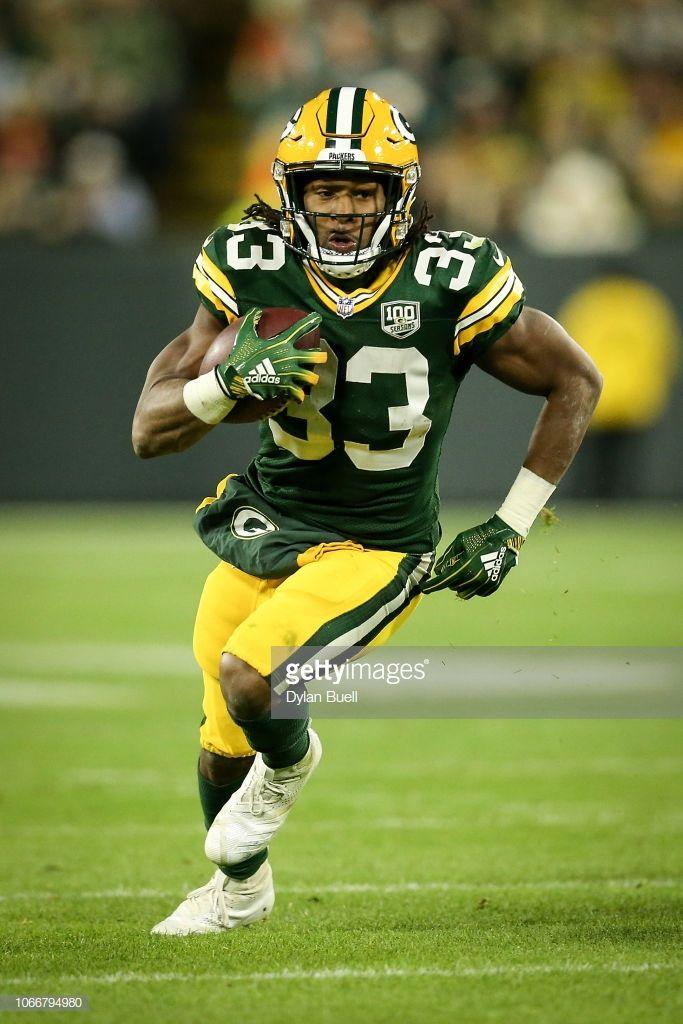 Aaron Jones Of The Green Bay Packers Runs With The Ball In The Third Green Bay Packers Green Bay Packers Wallpaper Green Bay Packers Football