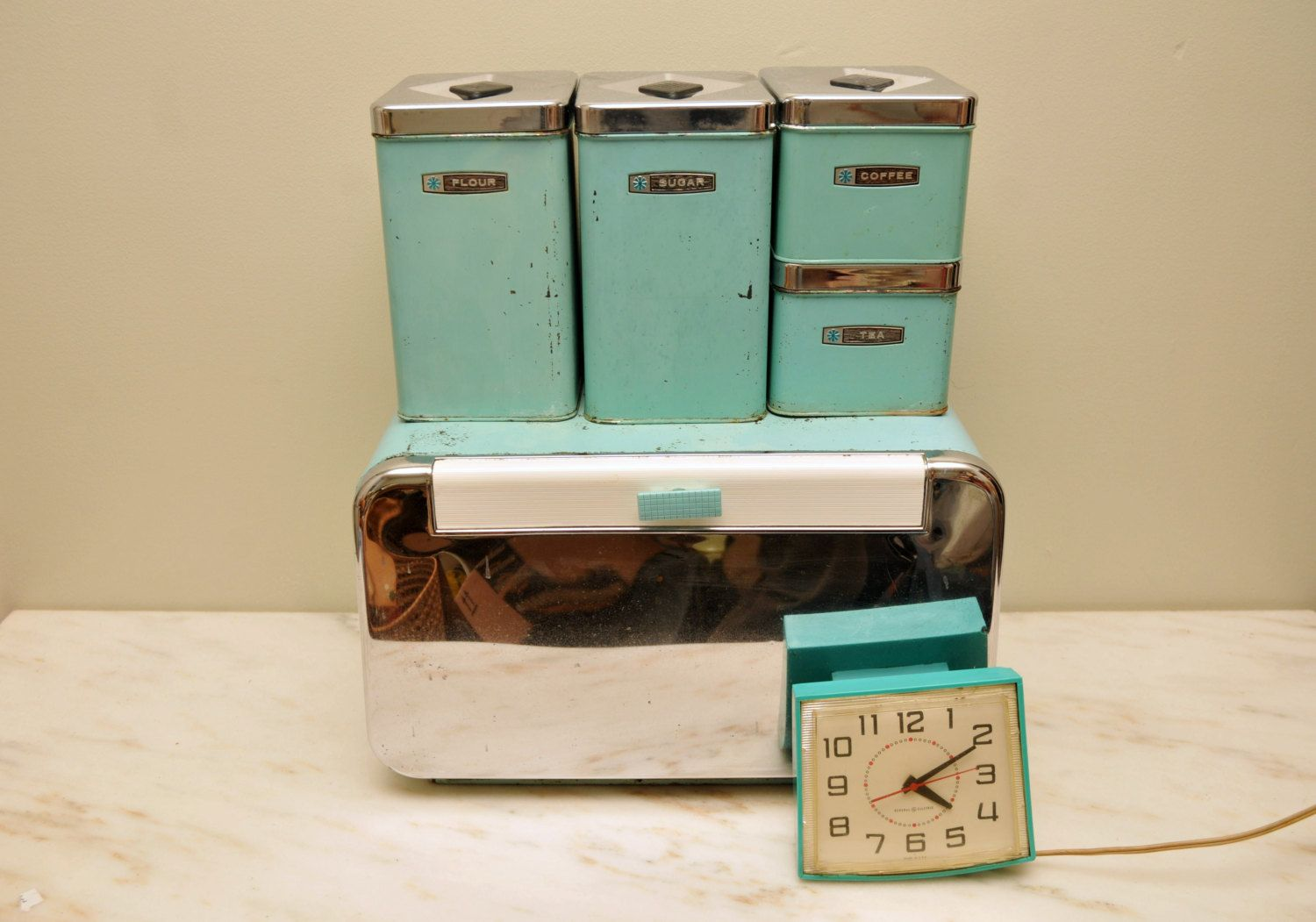 Vintage Turquoise Metal Kitchen Canister Set With Breadbox And Clock.  $62.00, Via Etsy.