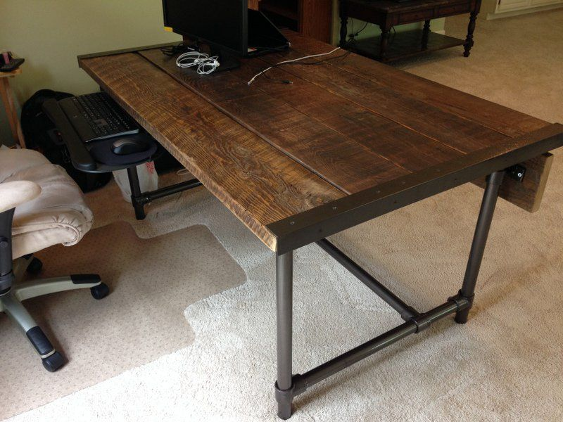 Andrew's desk has a lot of character, and the construction is fairly simple.  Kee
