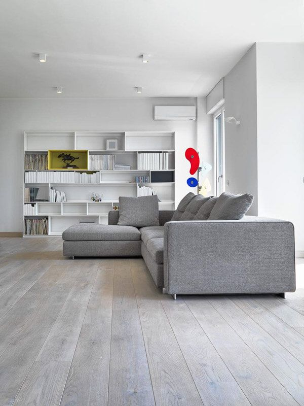 Well Lit Modern Open Plan Living Area With White Walls And Contrasting Grey Sofa And Timber Floo Grey Walls Living Room Timber Flooring Grey Flooring