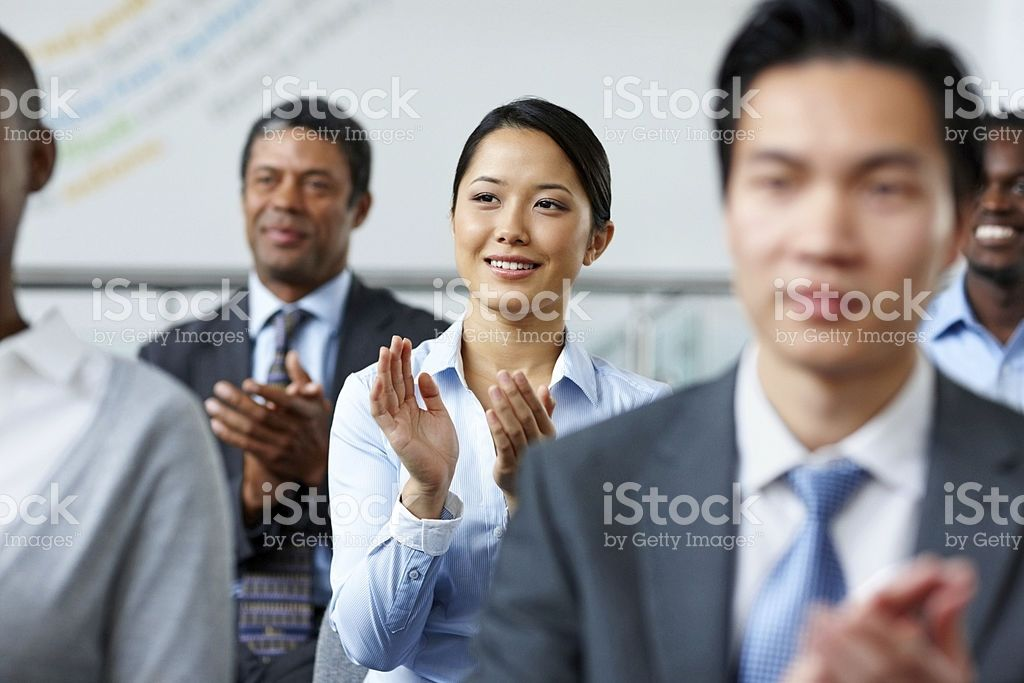 Successful Business Woman With Colleague Applauding At A Seminar