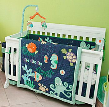 Baby nurseries with an ocean theme of ocean themed for Fishing baby bedding