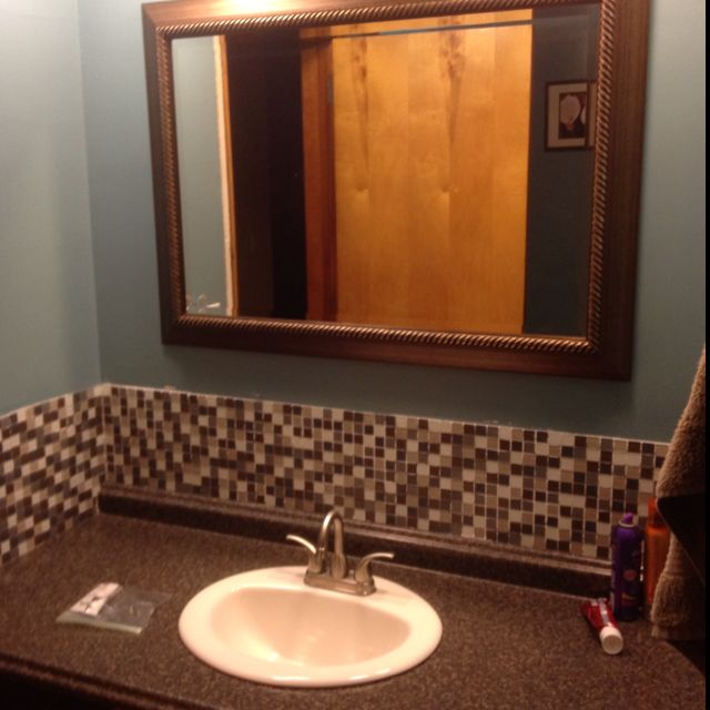 Bathroom redo. Still on progress but looks 110% better than before. John and I did all by ourselves.