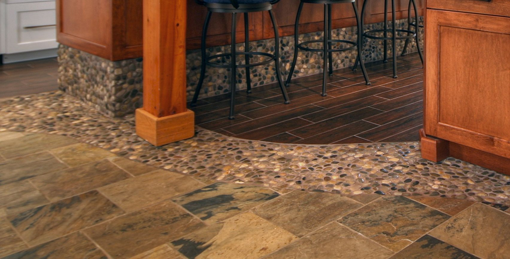 This kitchen floor transitions from wood like porcelain tile to this kitchen floor transitions from wood like porcelain tile to river rock to slate dailygadgetfo Choice Image