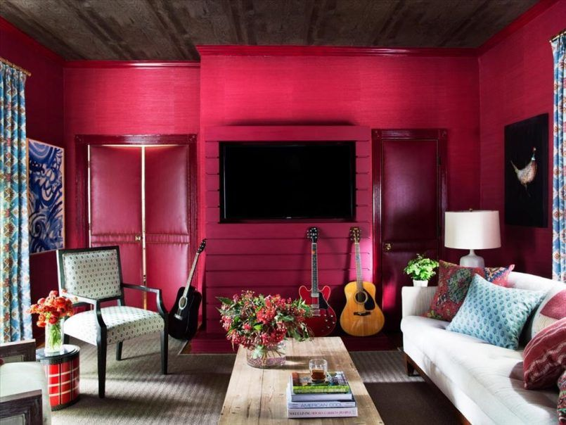Living Room Red Wall Black Television Painting Blue Cushion Sofa White Sofa  Wooden Coffee Table Armchair