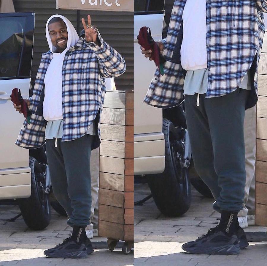 8a92bf289984a adidas Yeezy Wave Runner 700 Triple Black Spotted On Kanye u0027s Feet   u2022 KicksOnFire.com ...