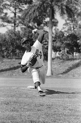 Sandy Koufax the contortionist pitching.