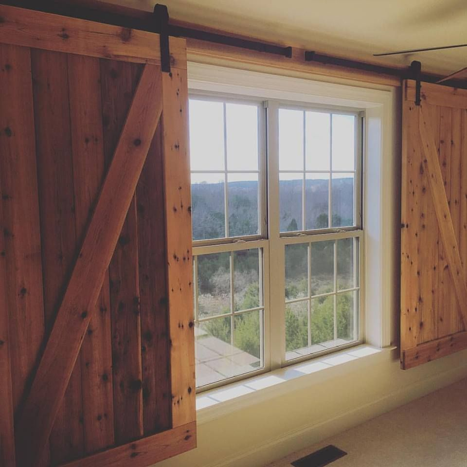 Barn Door Window Covering.Barn Door Hangers Used To Create Window Coverings In A Woman