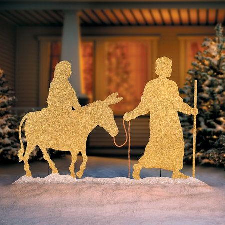 this metal christmas decoration with gold and silver glitter depicts the most religious aspect of the holiday season joseph leads mary on a donkey to - Religious Christmas Yard Decorations
