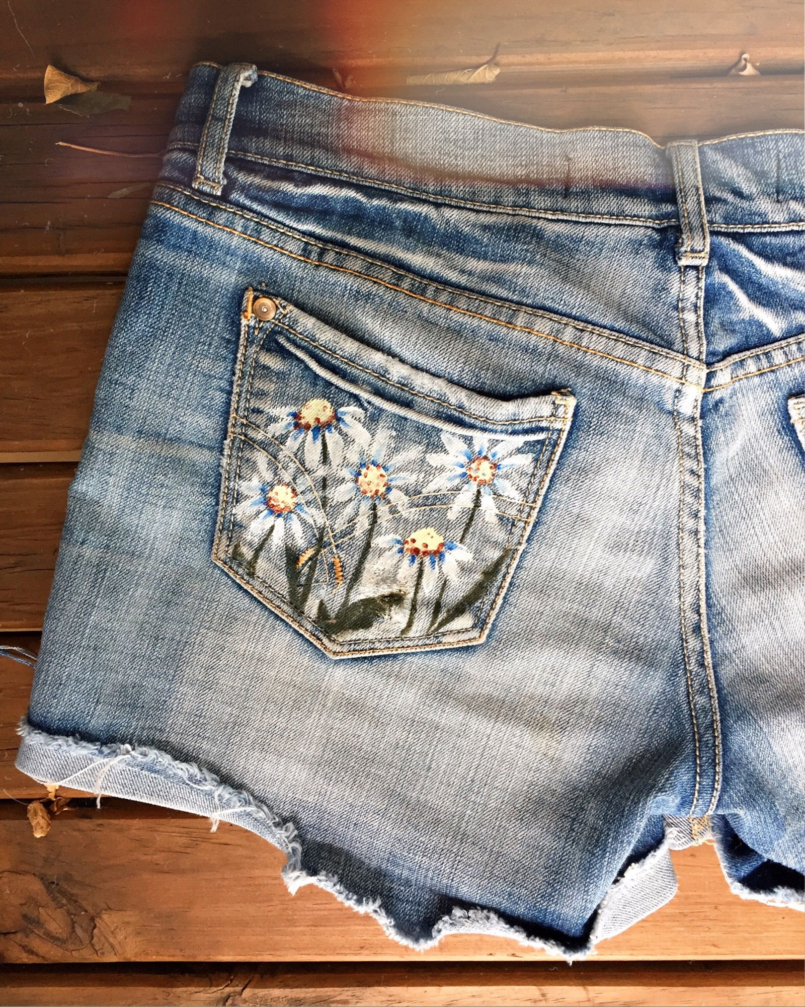 5a499e8b07868e no flowers (part 3) // hand-painted thrifted denim shorts by  @peppermintlines