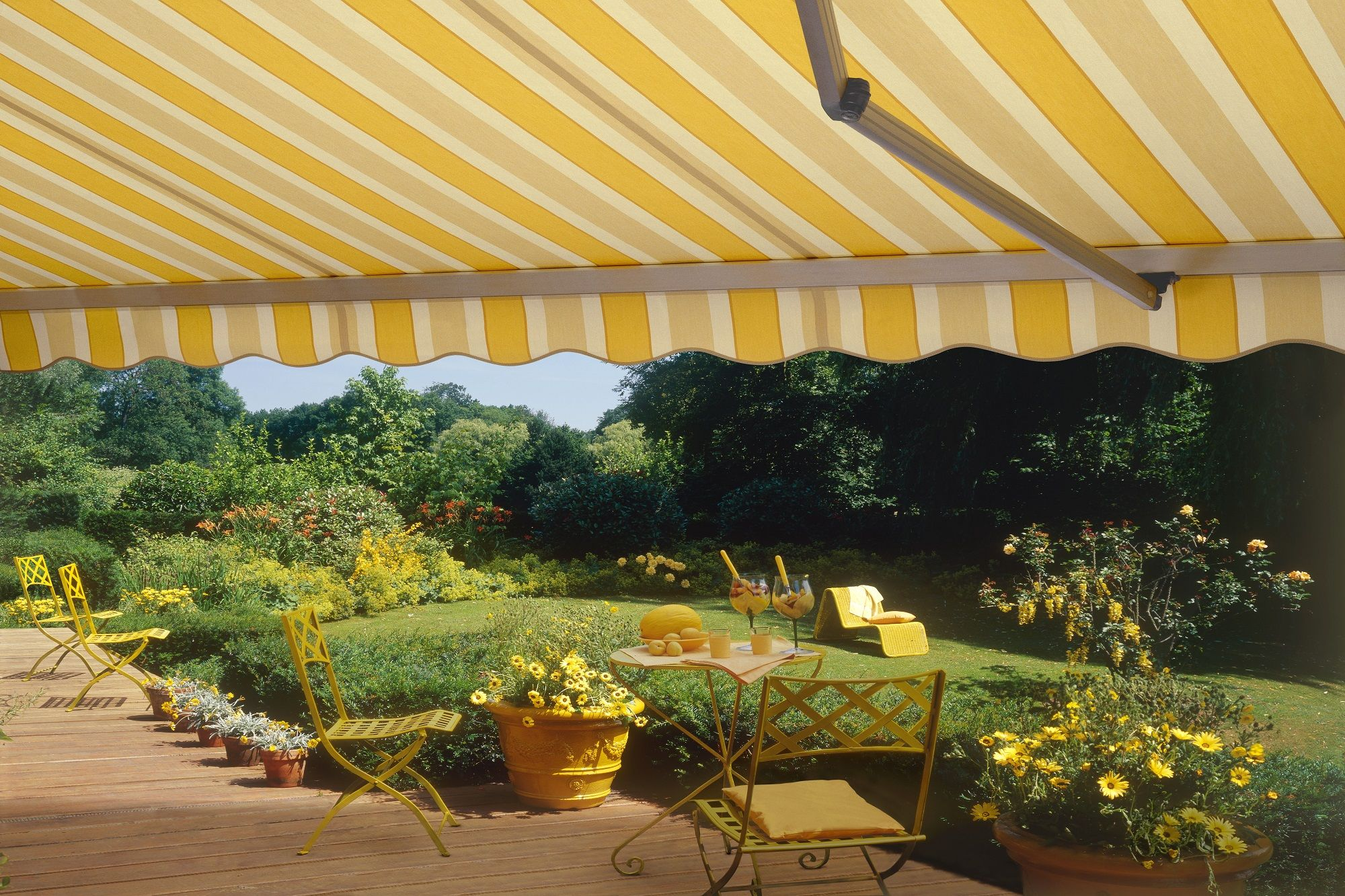 Retractable Folding Lateral Arm Canvas Striped Awning In A German Garden Covered Pergola Deck With Pergola Outdoor Decor