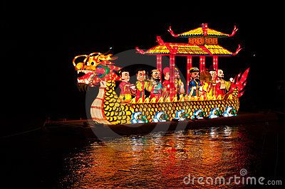 Night shot of dragon boat with lamp in river by Kobchaima, via Dreamstime