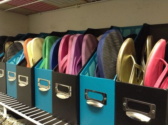 Use magazine holders as storage for your flip flops. Looks great, easy to access, and best of all, no more ugly shoe boxes!