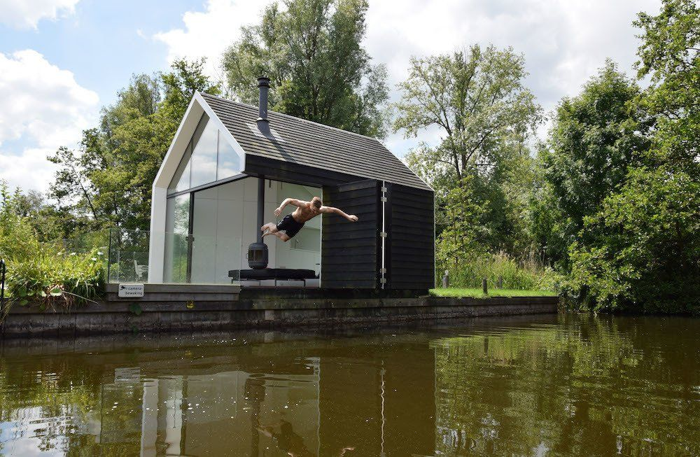 101 Best Modern Cabins - Photo 22 of 101 - Subtle features incorporated into the design, including an elevated terrace and jetty, help the home float above the island.