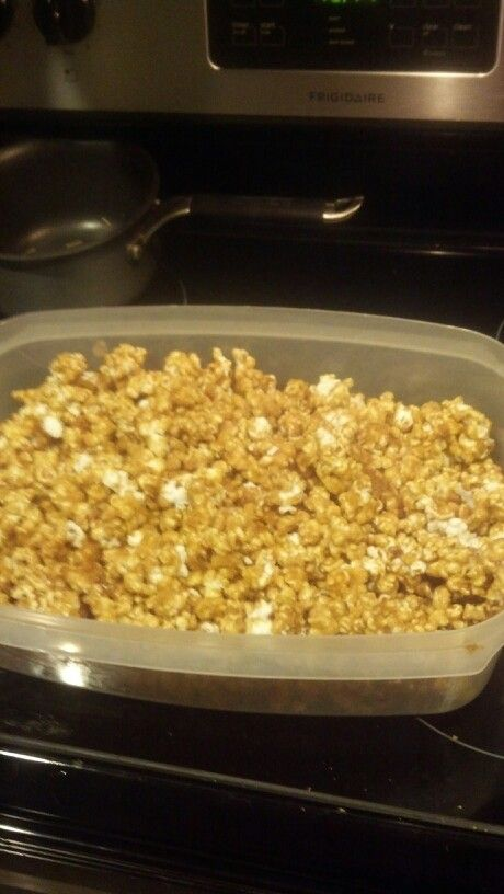 My Momma's HomeMade Caramel Popcorn (Yummy in Your Tummy!)   2 sticks of butter 2 cups of brown sugar 1/2 cup white corn syrup Teaspoon salt  Bring ingredients to a boil. Boil for 5 minutes. Remove from heat. Mix in 1 teaspoon of vanilla extract and 1 teaspoon of baking soda.  Coat popcorn and mix well. Bake at 200 degrees for one hour.