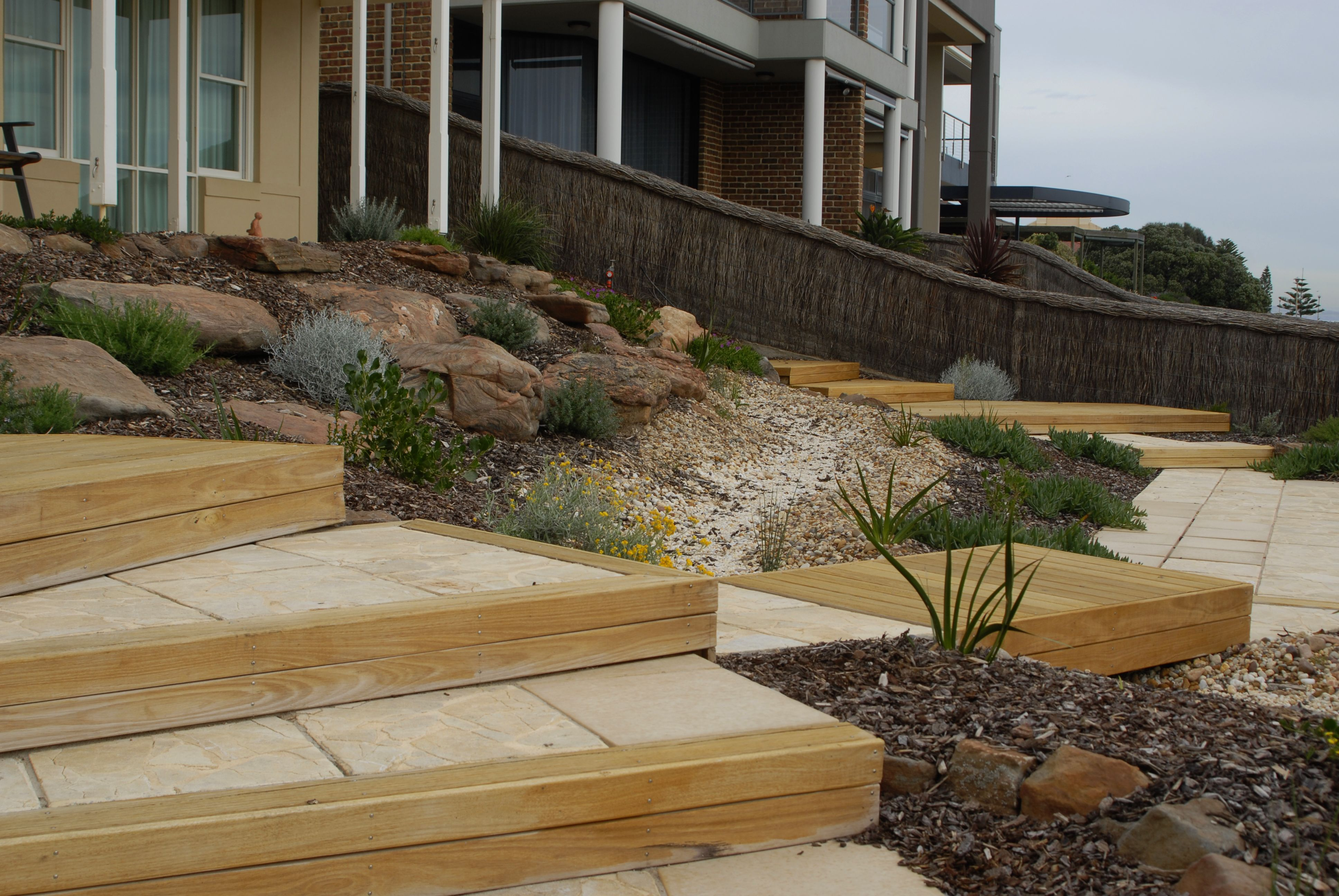 Angled decks and steps allow for access to the beach ...