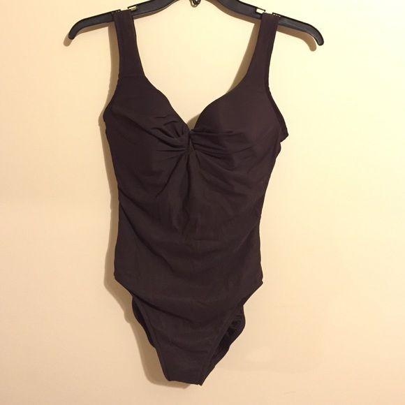 One piece bathing suit One piece bathing suit in excellent condition.  Deep brown color, Size 10 Miraclesuit Swim One Pieces