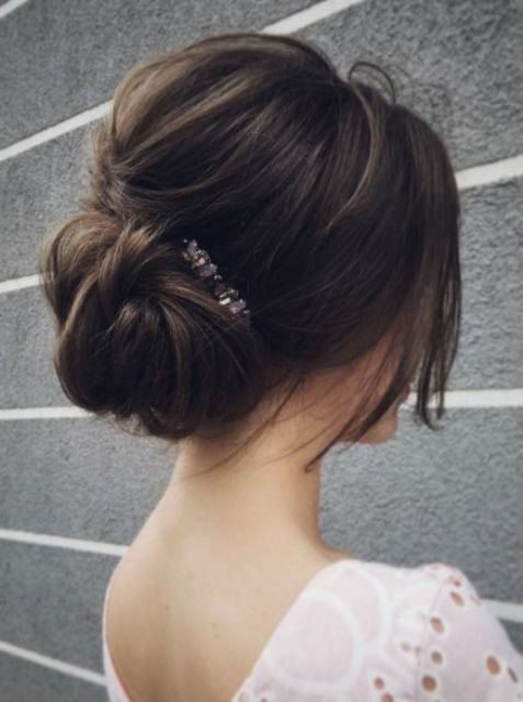 A Messy Low Bun With A Bump And Some Textural Hair Down Plus A Rhinestone Hairpiece For An Effortlessly Chic Loo Long Hair Styles Wedding Hair Inspiration Hair