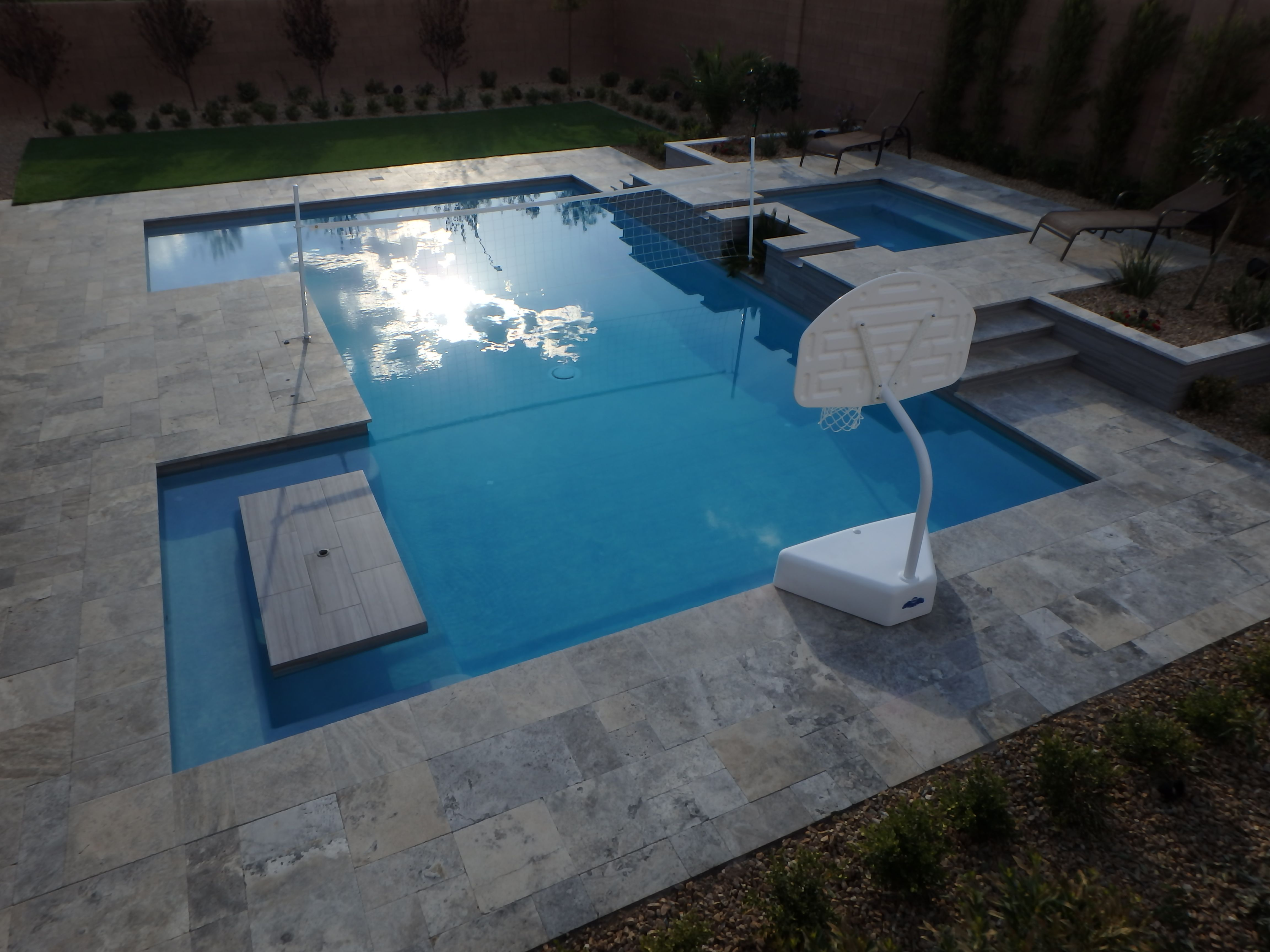 This Pool Has Great Fun In The Sun Options Spillover Spa Built In Table Benches Umbrella Sleeves Pole Holders For Volleyball Pool Bench Table Pole Holders