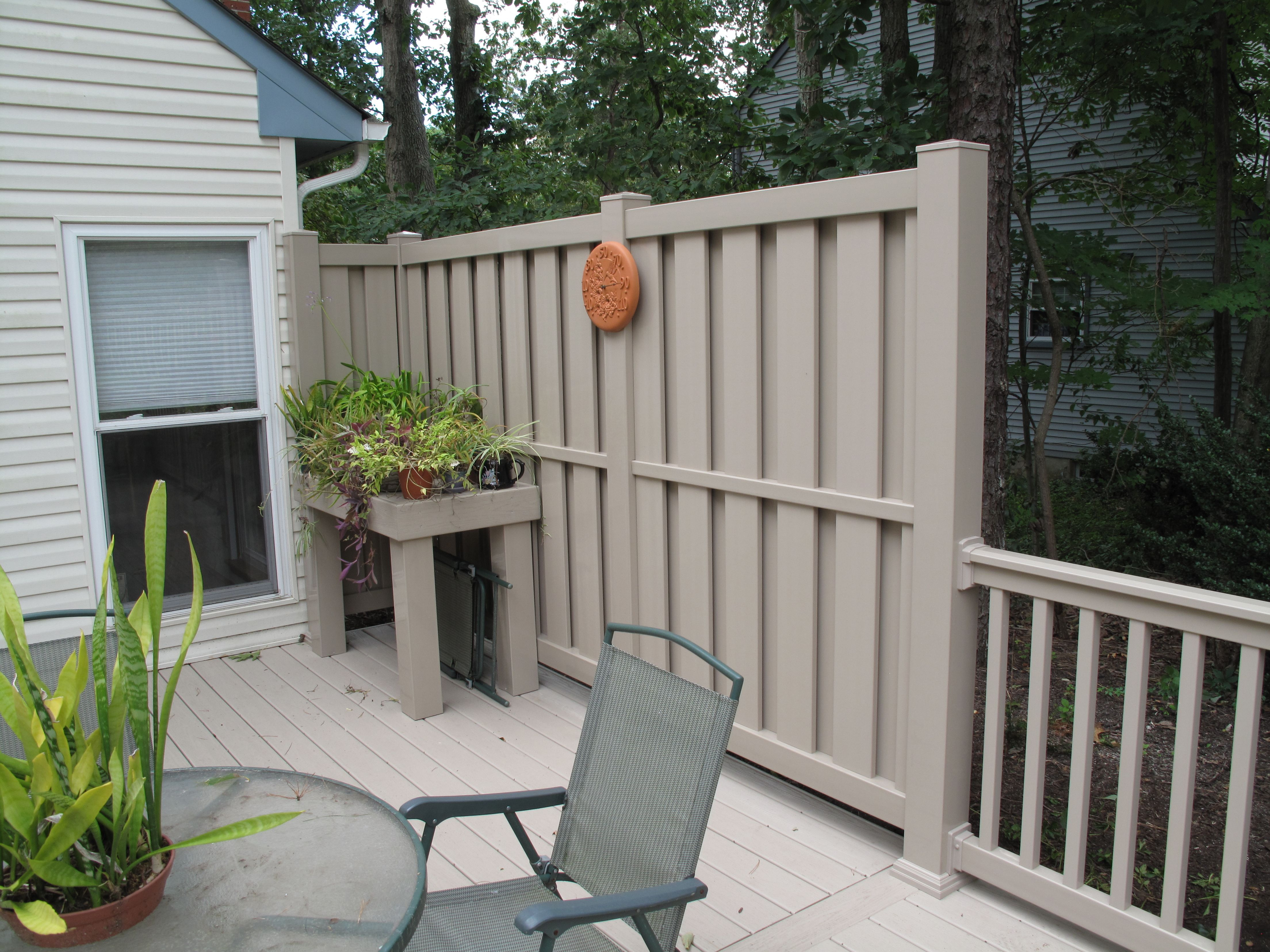 This tan vinyl shadowbox fence is done using Great Railing