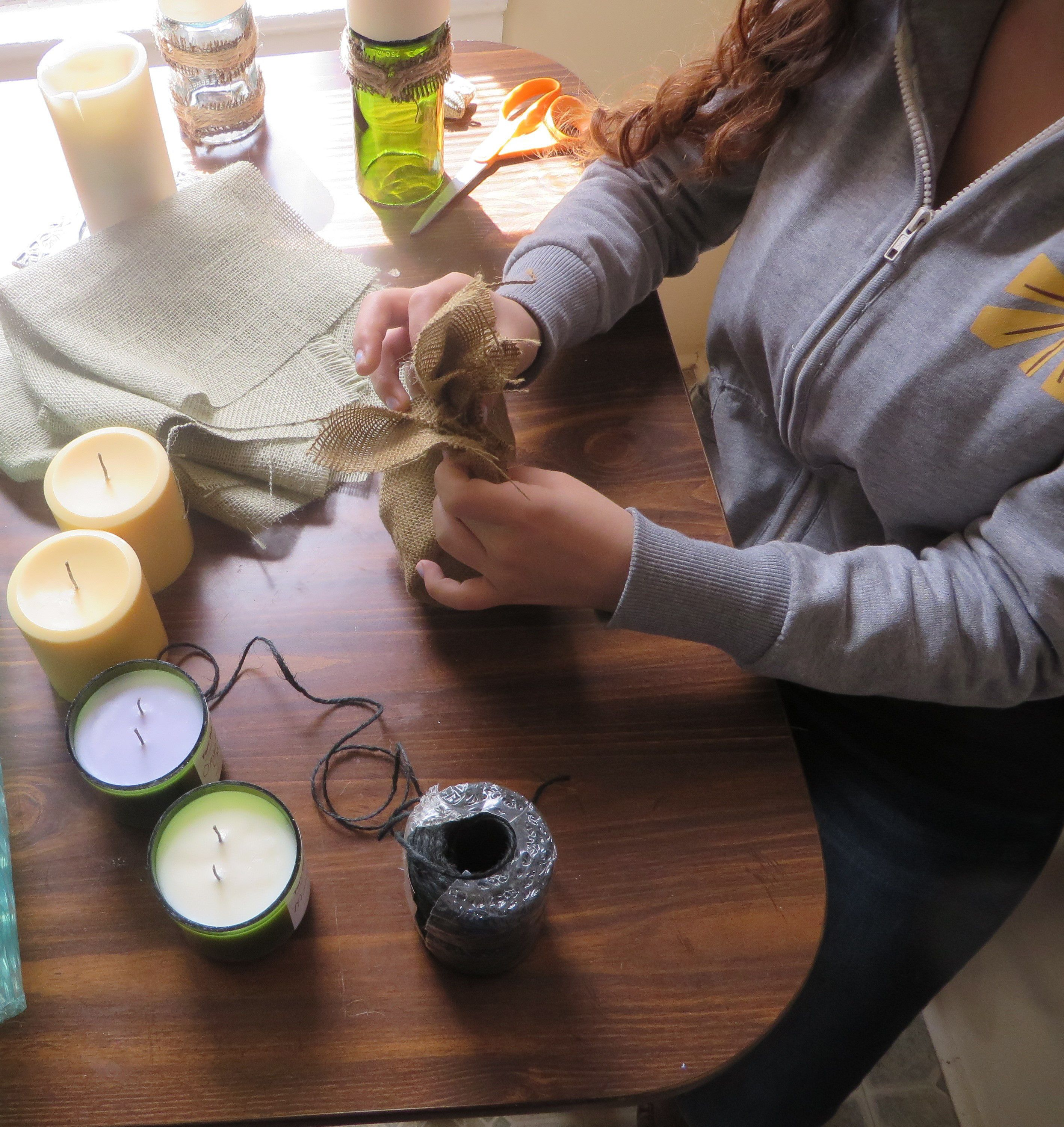 Step 4: wrap the top with all natural hemp or jute that is slightly thicker to tie it all together