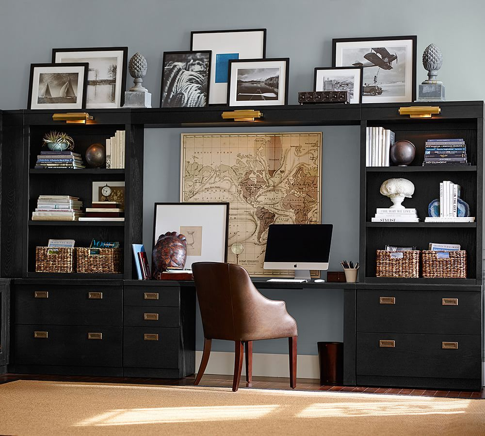 black built in shelving and brass hardware gives this home office suite maximum organization and