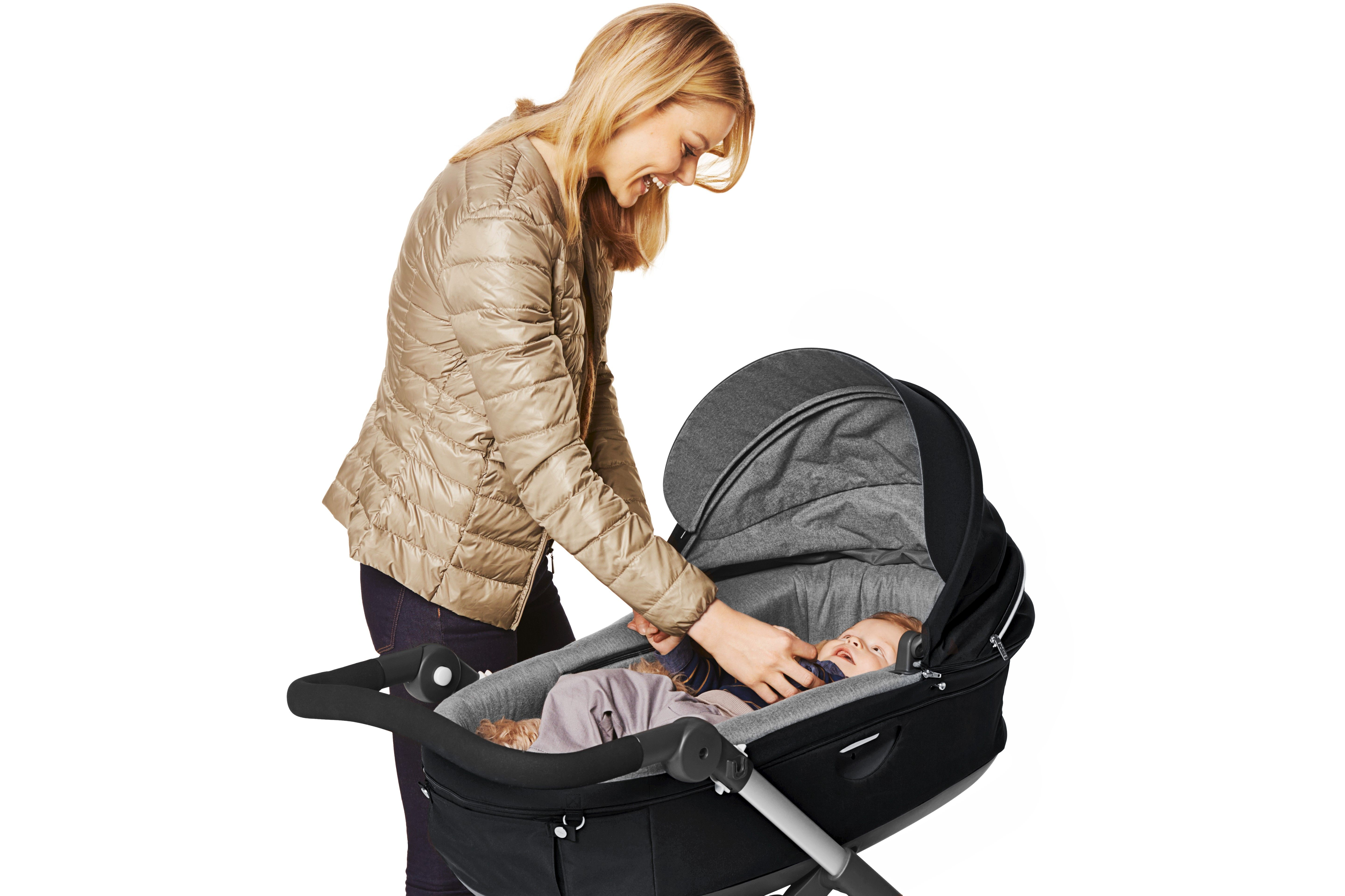 Like all Stokke® strollers, the carry cot and seat positions of new Stokke® Trailz™ lift your baby higher to encourage connection between parent and child.