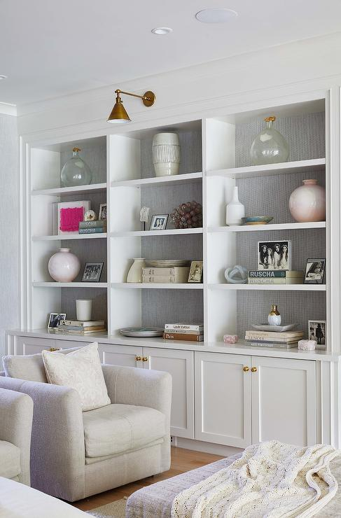 Photo of Gray Wallpaper Installed on Back of Built Ins – Transitional – Living Room