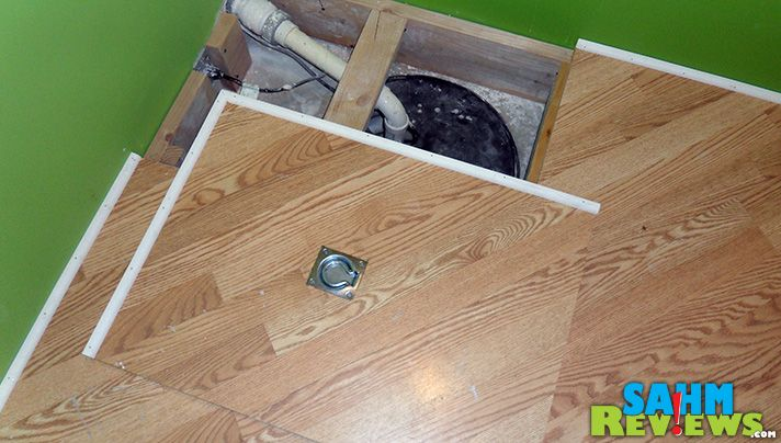 How To Hide Your Sump Pump Hole Sahmreviews Com Sump Pump Cover Basement Makeover Basement Remodeling