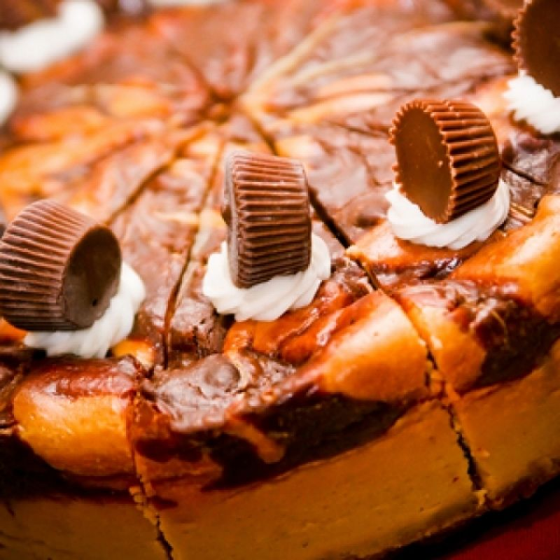 A decadent peanut butter cup cheesecake recipe that is marbled with chocolate and a crunchy wafer crust.. Chocolate Marble Peanut Butter Cup Cheesecake Recipe from Grandmothers Kitchen.