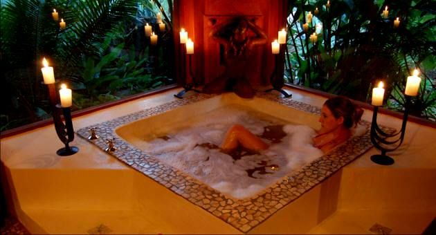 The seduction of this large candle lit bath is dreamy and ...