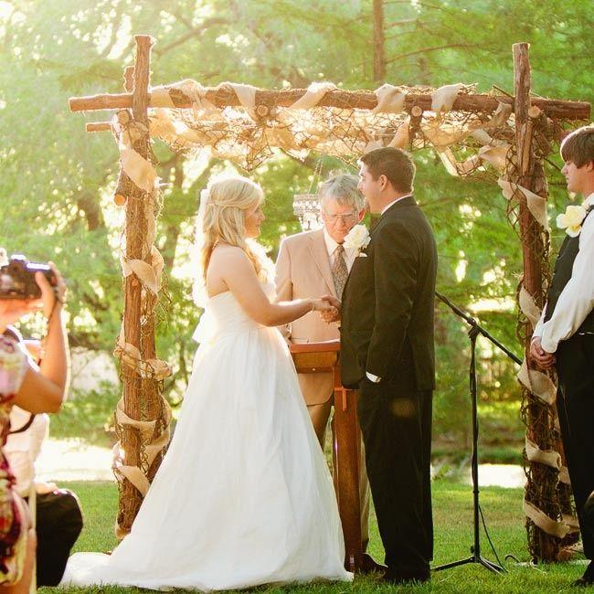 rustic wedding arbor photo spink studio