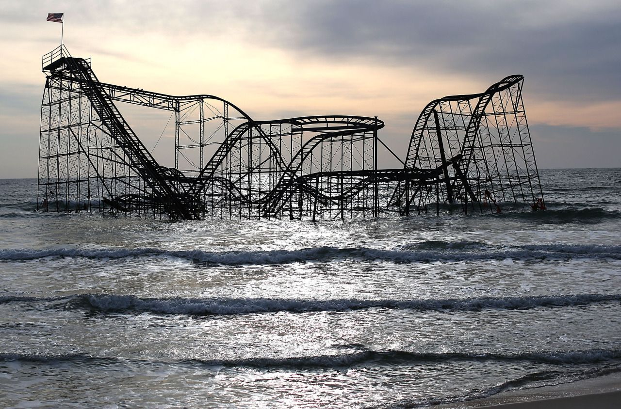 rcah:  sixpenceee:  Hurricane Sandy dropped the Casino Pier roller coaster into the Atlantic Ocean, just off Seaside Heights,  i remember driving past this right after sandy hit and it was the most insane thing i've ever seen