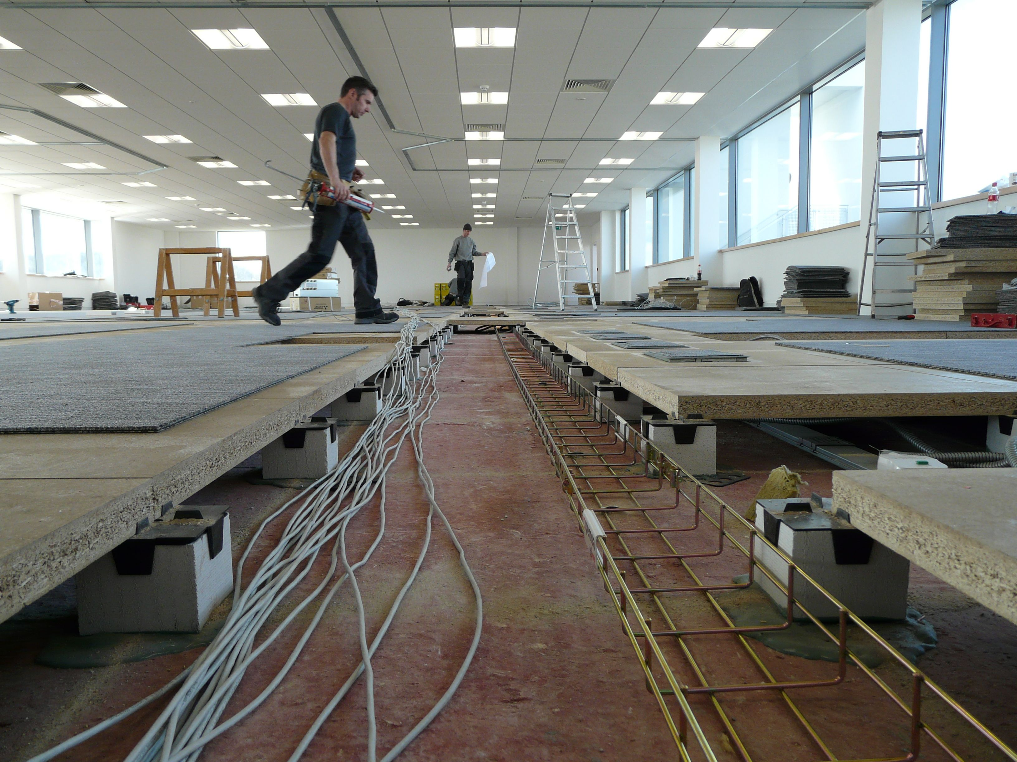 Raised access flooring laying cat 5e data cables design for Raised floor house