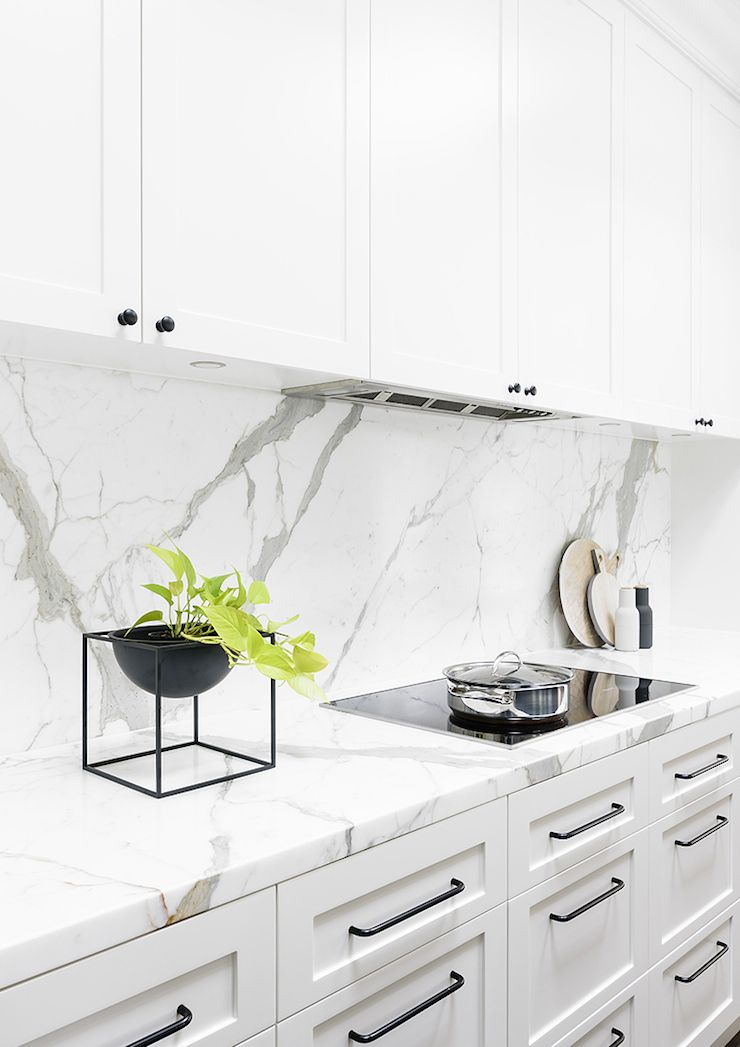 White Kitchen Handles calcatta oro marble counters and backsplash | biasol design studio
