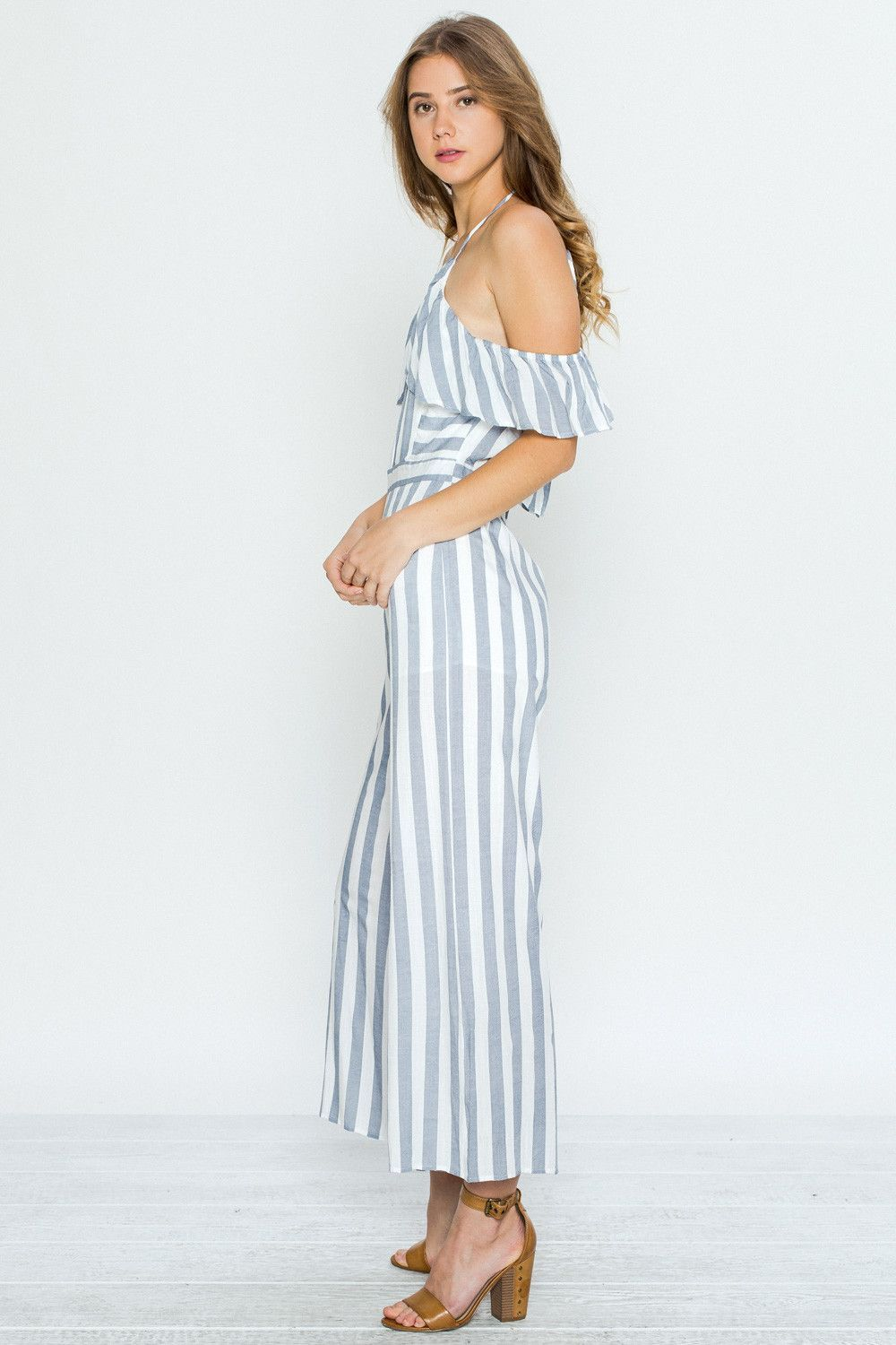 0b08fed3e18 Be a fashion statement in this this Off Shoulder Blue Striped Ruffle  Jumpsuit. It features an adjustable strap halter top and full back look  with an off ...