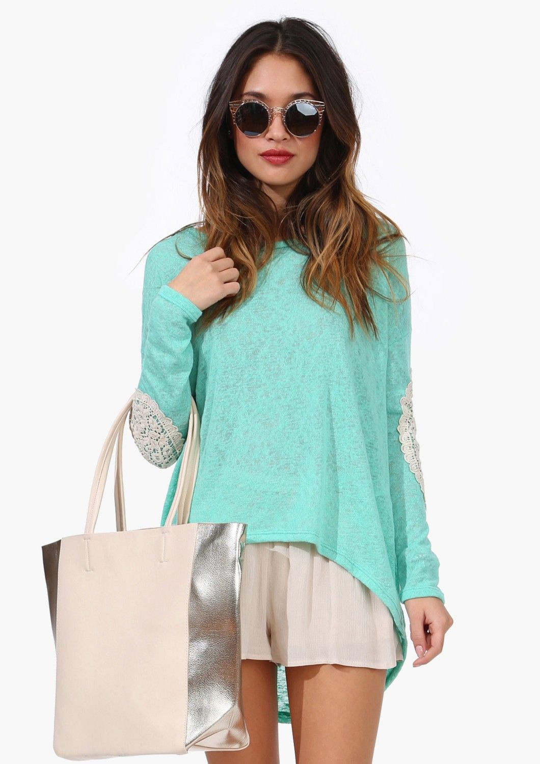 Sweater withlace embellishment on elbow patches