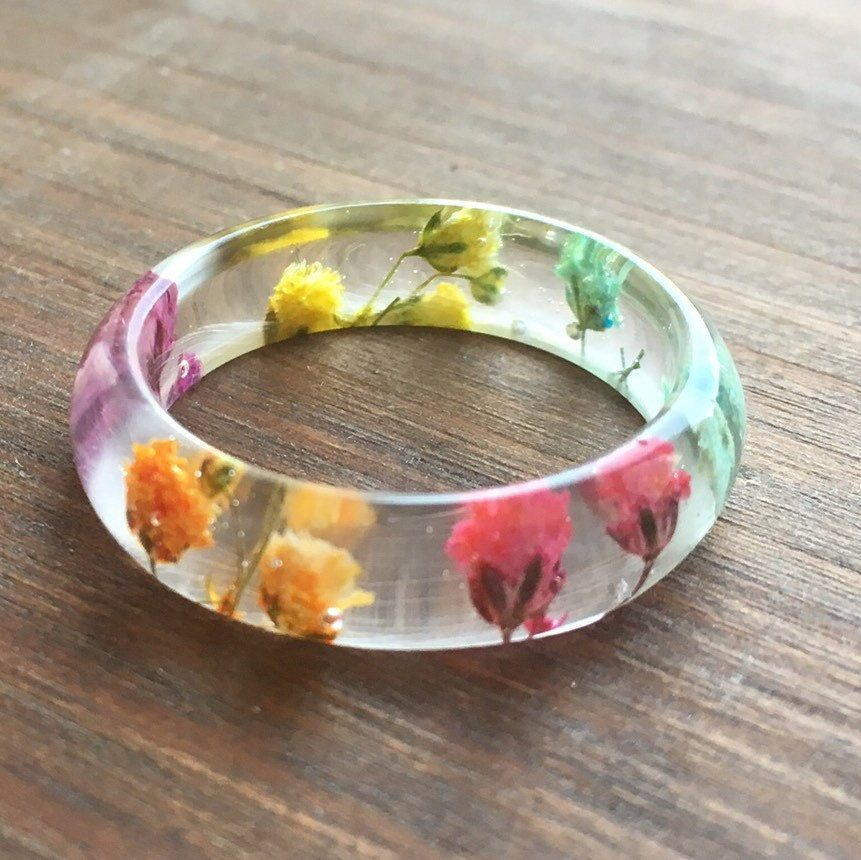 Real hand pressed and hand dyed gypsophila flowers encased in a beautiful and delicate ring now available in my Etsy shop