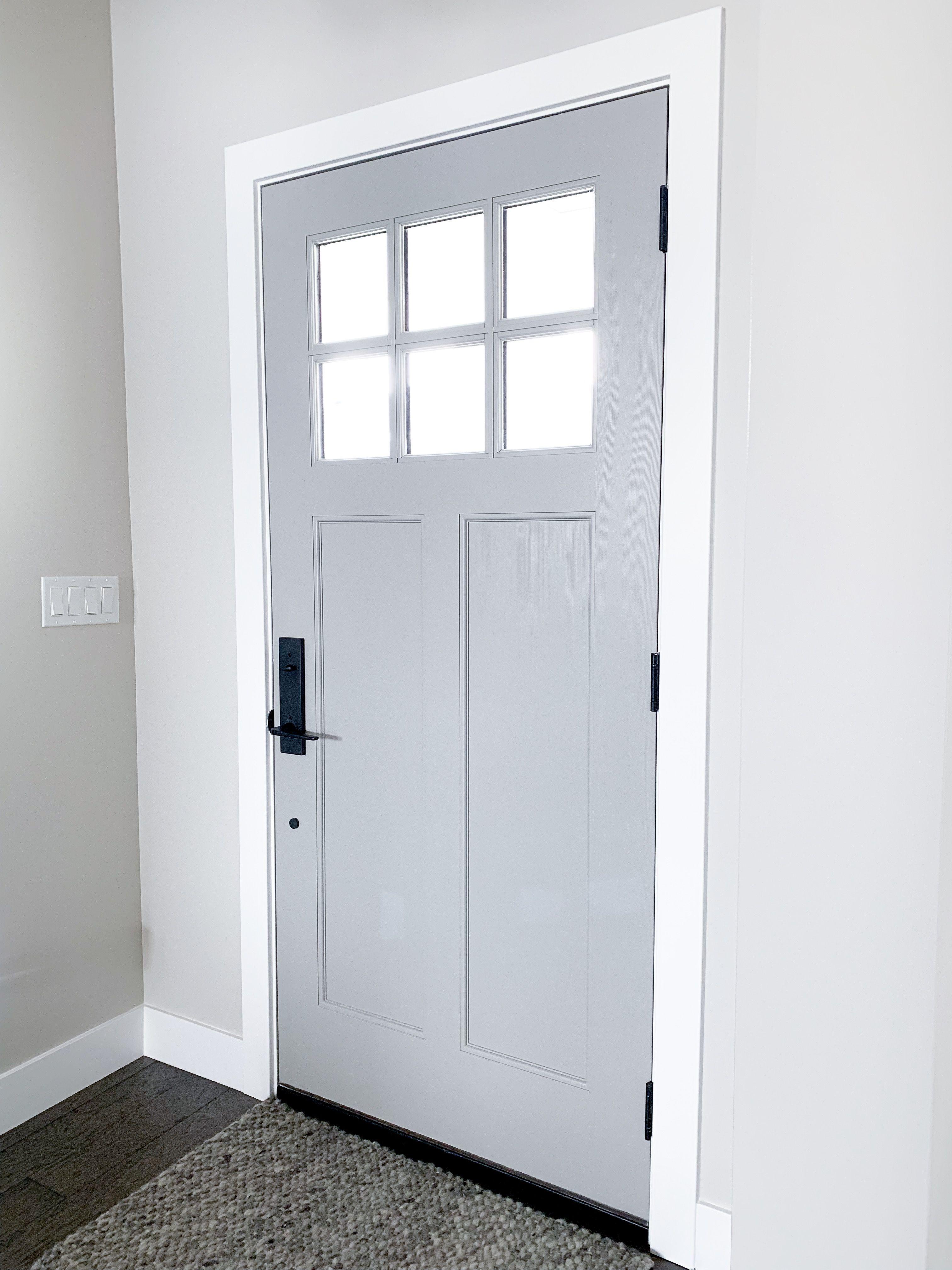 Our Front Door Craftsman Style With Upgraded Matte Black Emtek Hardware Craftsman Style Doors Craftsman Style Exterior Grey Front Doors