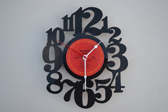 Handcrafted vinyl record clock artist is Aerosmith by vinylclockwork on Etsy, $23.00